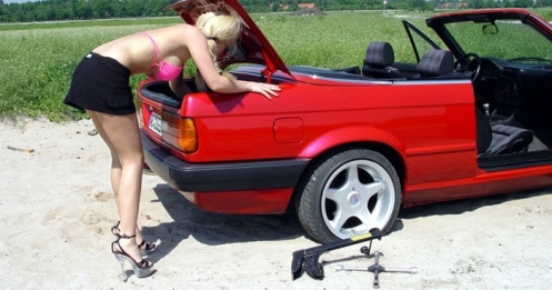 hot chick changing tire